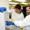 Luis Montaner (right) and a lab assistant at the Wistar Institute retrieve samples from liquid nitrogen frozen storage.