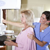 Woman gets a mammogram